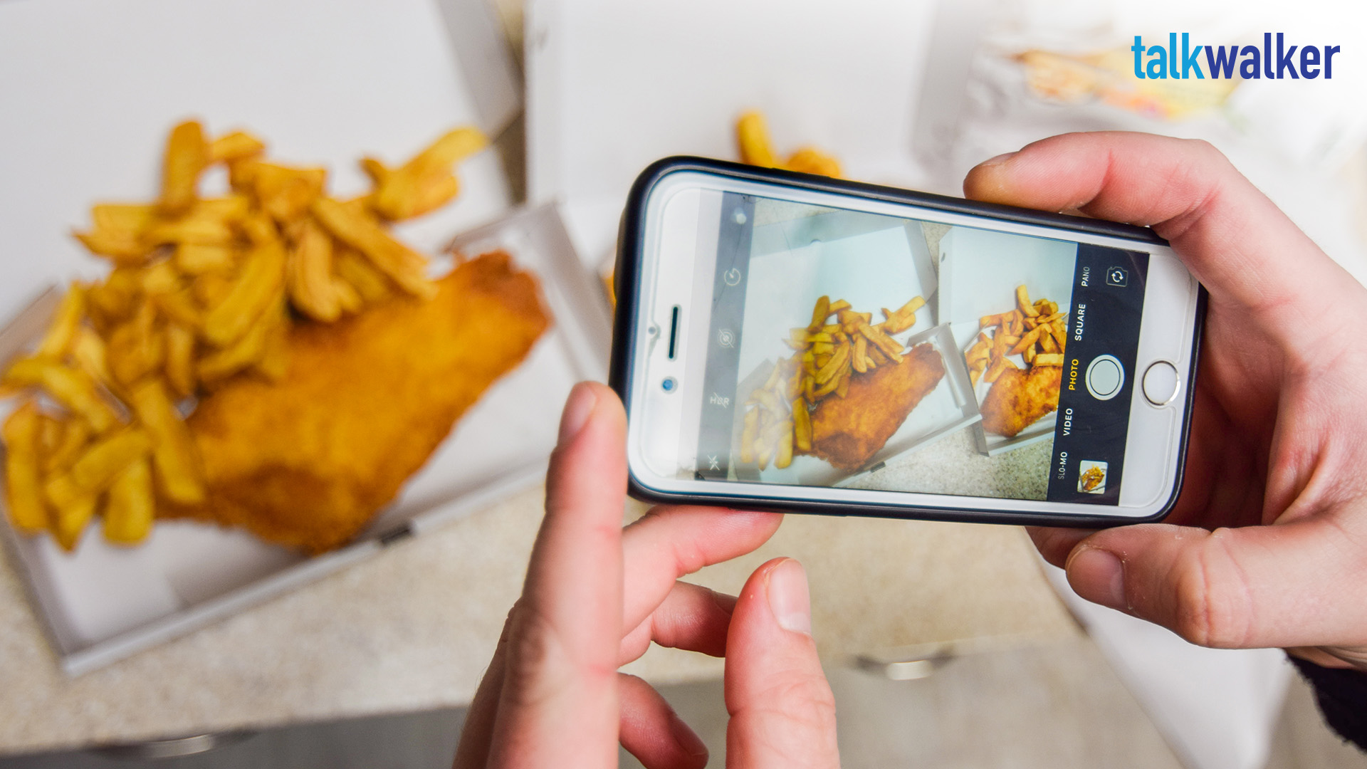 UK influencer taking picture of food with smartphone
