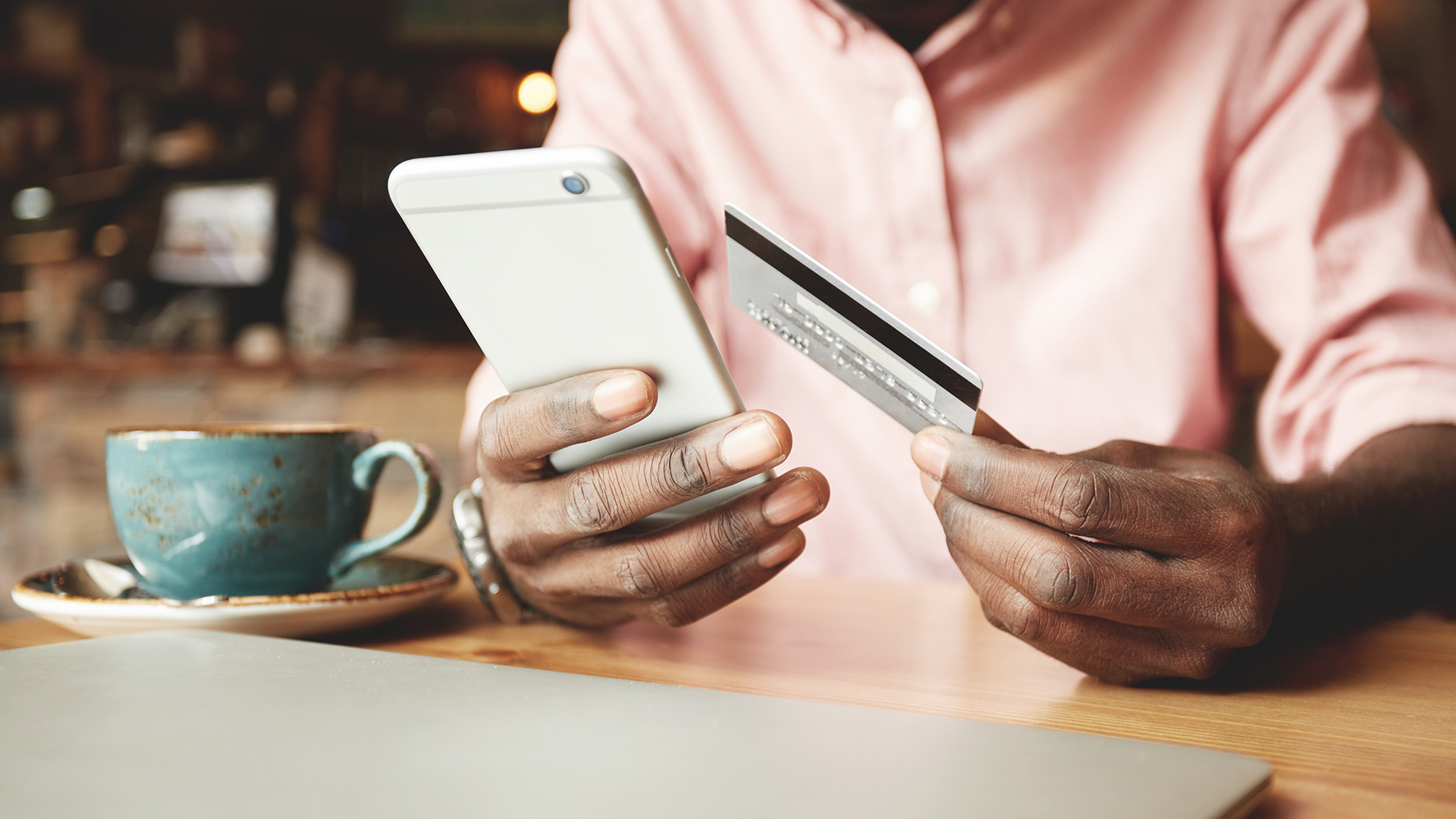 A man has been identified through consumer research as likely to purchase a given product and does so via his mobile phone and credit card
